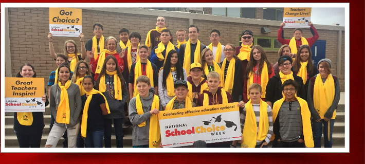 students with yellow scarves