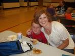 Kindergarten parents eat lunch with their students