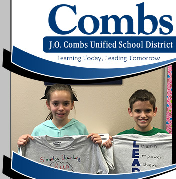 2 students holding Tshirts