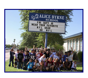 Students in front of school sign