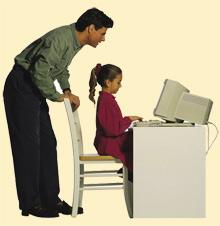 Man and Girl looking at computer