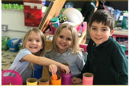 Three happy students playing