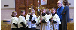 A group of altar students preparing for a Mass