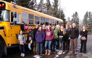 students standing near school bus