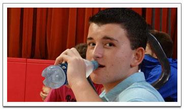 boy drinking from water bottle