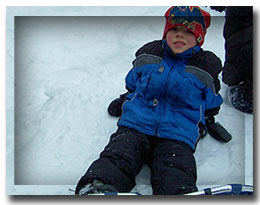 boy in snowshoes