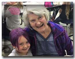 older woman and child with purple hair