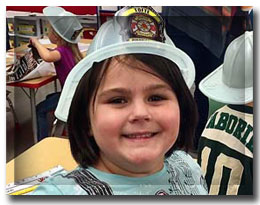 little girl with fireman hat
