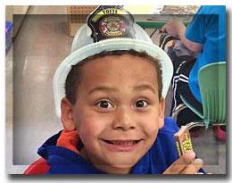 boy in firemans hat