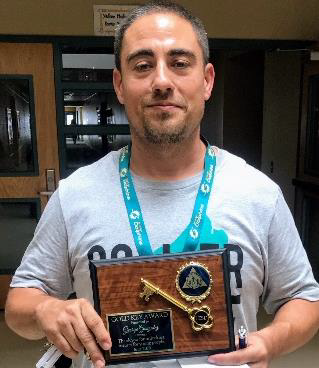 George Gonzales with Gold Key Award