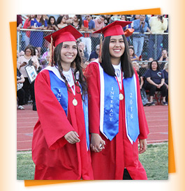 Two graduates in red