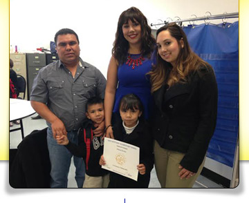 Student with award and family