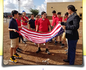 students folding the flag