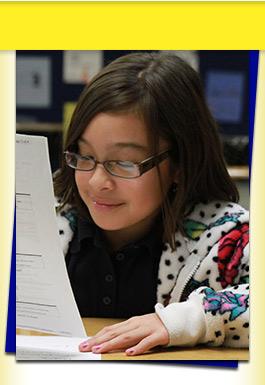 Girl reading paper
