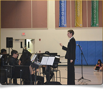 Student conducting orchestra