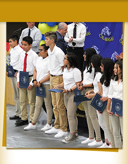 Middle school students receiving awards