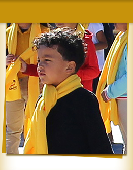 Elementary school boy with yellow scarf