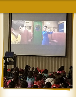 students watching a movie on a big screen