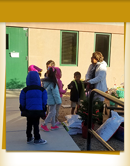 Teacher outside with a group of students