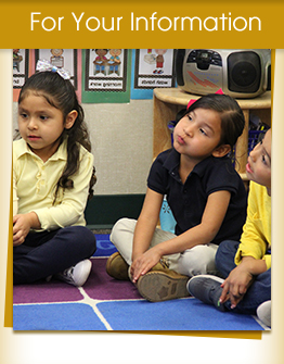 For Your Information - three elementary students sitting on the classroom floor