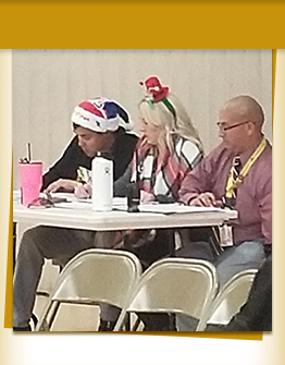 Adults sitting at a table during a meeting