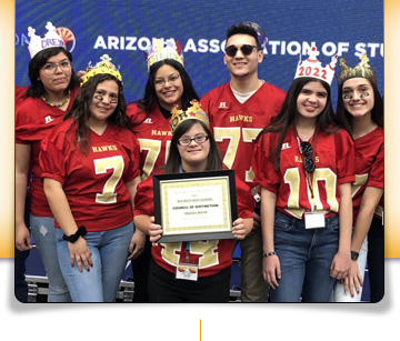 Group of students with crowns and certificate