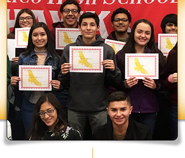 Group of Rio Rico High School students holding up award certificates