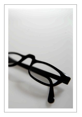Cropped Close-up of Reading Glasses