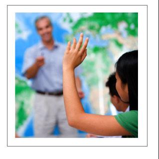 Student Raises Hand in Classroom
