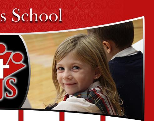 little girl in uniform smiling