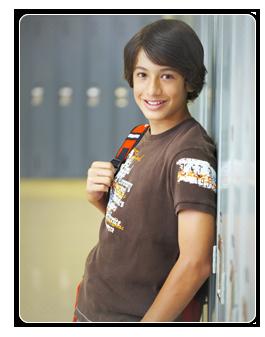 Student standing by locker