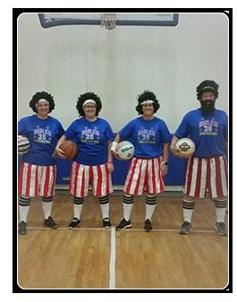 Teachers dressed up as the Harlem Globe Trotters