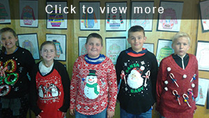 Five students wearing ugly Christmas sweaters