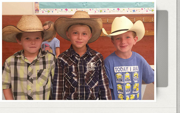 3 boys in cowboy hats