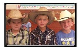 3 boys in cowboy hats