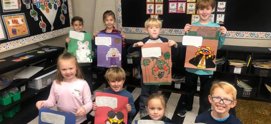 students showing school work