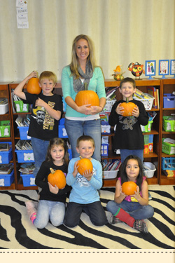 students with pumpkins