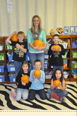 srudents with pumpkins