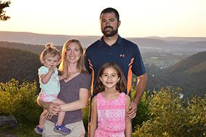 Dr Zane Raudenbush and family