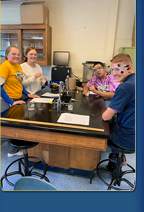 high school students wearing googles in the lab