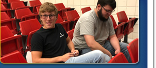 student smiling in theater seat