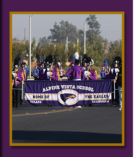 Marching Band holding school banner