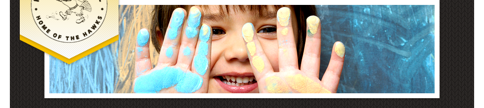 Smiling Kindergarten Student with Blue and Yellow Chalk on Hands