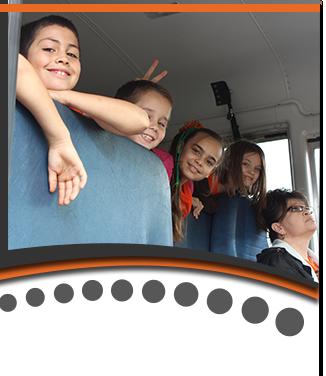 Happy Students in School Bus