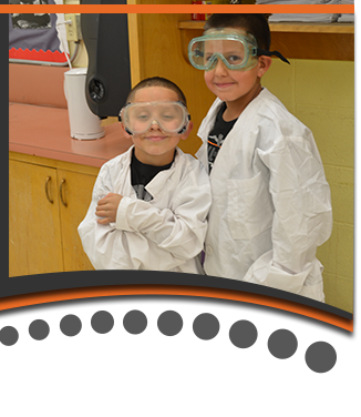 Students Wearing Science Lab Coats and Safety Goggles